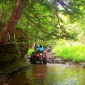 An ATV rider in the woods at MacMillan Creek in Conesus, New York