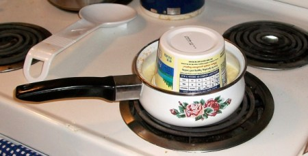Tub of butter upside down in saucepan