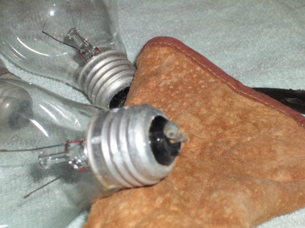 Light Bulb Wall Vase - light bulb lying on towel