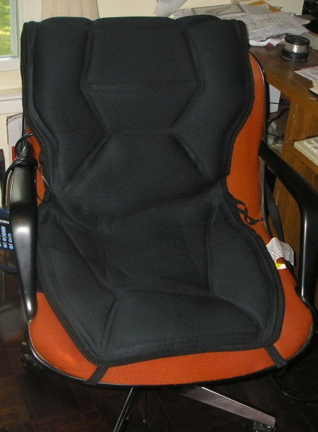 A heating/massage pad on an office chair.