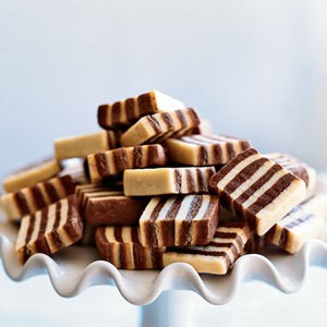 A tray of black and white striped cookies.