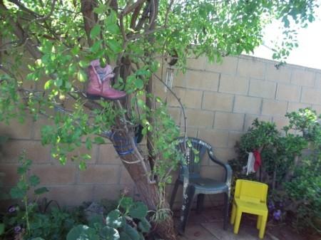 Cowgirl Boot Birdfeeder in Tree