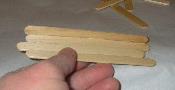 first perpendicular stick glued onto base sticks