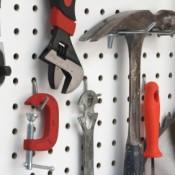 Photo of tools hung a peg board.