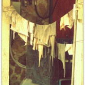 Laundry hanging on line in doorway