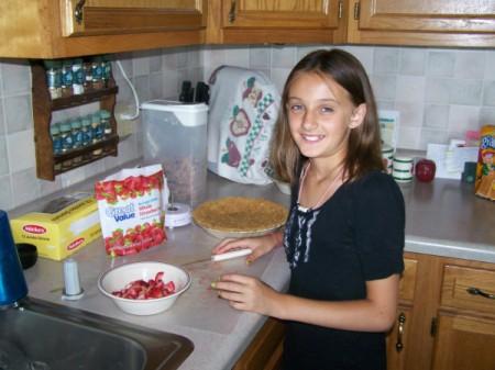 Grand-daughter Hayley preparing strawberry pie