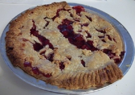 A smiling cherry pie.