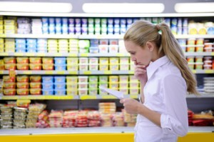 A woman looking at her shopping list.