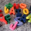 Alphabet crayons on counter