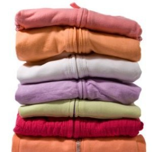 Storing Out of Season Clothing, Stack of folded sweaters in different colors