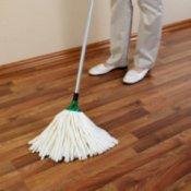 Someone mopping hardwood floors