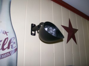 Solar light mounted on interior house wall
