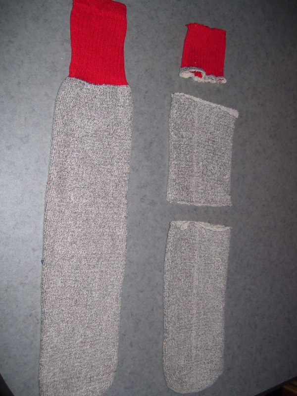 Photo of tube socks with one cut as per directions.
