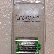 "Plastic adhesive nail packing with batteries inside and ""charged"" written on the outside"