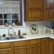 Corner photo in new kitchen of counter with rooster decoration.