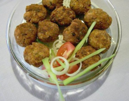 Salmon fritters in a bowl.