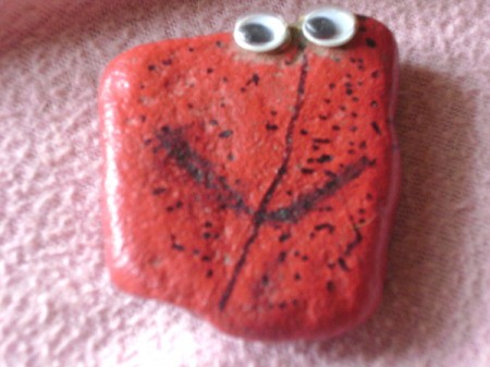 Red Pet Rock with google eyes