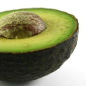 A ripe avocado cut in half.