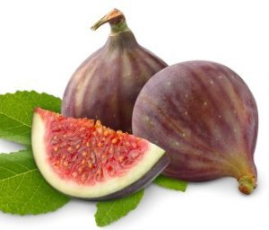 Two figs with one cut sitting on a leaf.