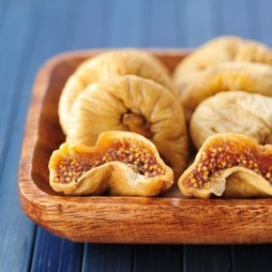 Dried figs in a wooden bowl.