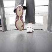 Woman's Feet Running on Treadmill