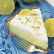 Slice of Key Lime Pie on Blue Plate with Fork
