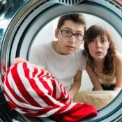 Picture of a red striped shirt in a washer.