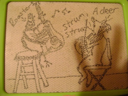 Magnadoodle drawing of a rooster playing dueling guitars with a deer