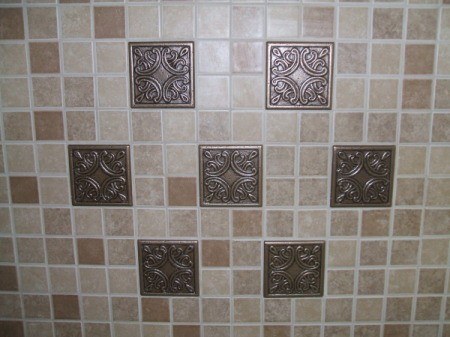 Completed tile back splash made up of small tiles and 7 large tiles