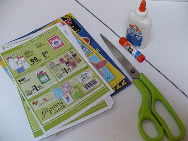 sheets of paper, scissors, glue and glue stick on a table