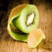 A partially peeled kiwi.