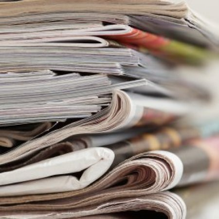 Stack of magazines and newspapers.