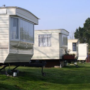 Row of holiday trailers in a park.