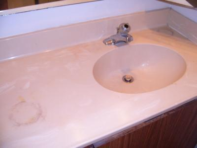 Before photo of painted laminate countertop.