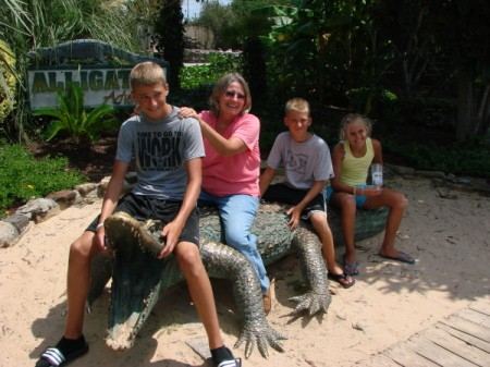 Tough Grandma on Alligator Sculpture with Grandkids