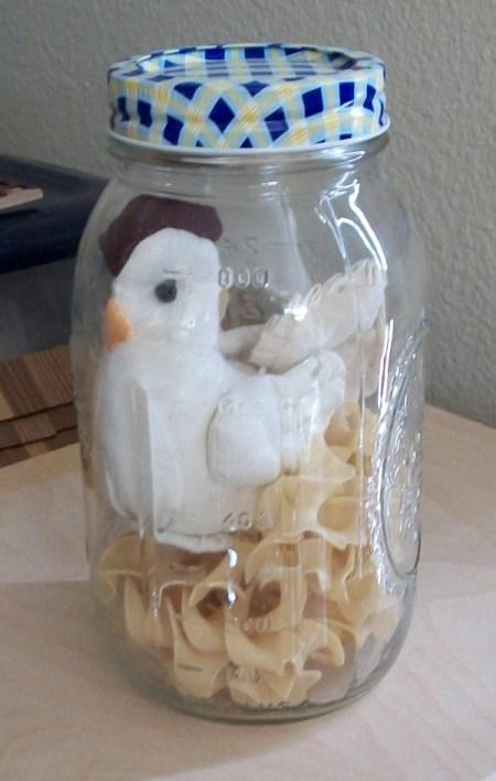 """Chicken"" and egg noodle pasta inside of a quart mason jar"