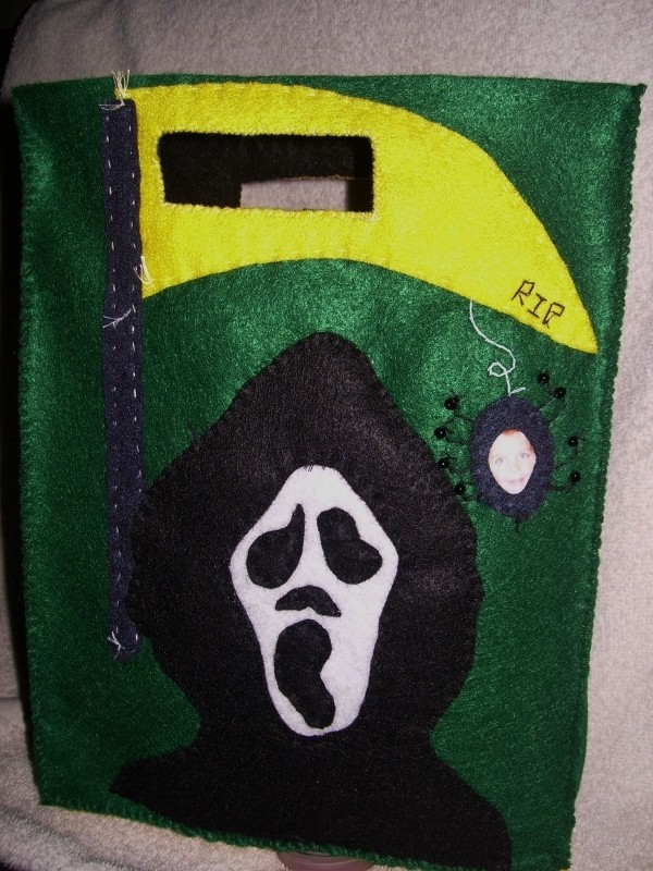 Green treat bag with grim reaper motif.