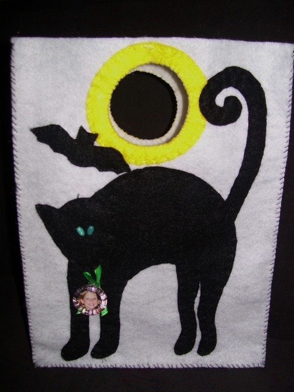 White bag with stylized Halloween cat, bat, and full moon.