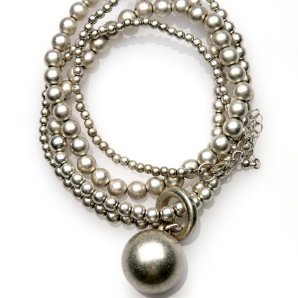 Coiled silver bead necklace with large silver ball.
