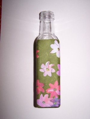 third side of bath salt bottle with flowers applied to green paper wrapped around it