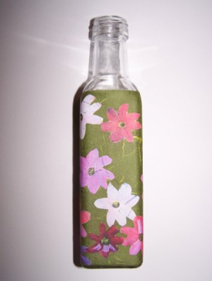 second side of bath salt bottle with flowers applied to green paper wrapped around it