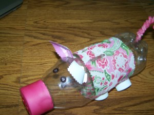 Homemade piggy bank crafts thriftyfun for Plastic bottle piggy bank craft