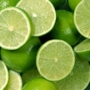 Whole limes and limes cut in half.