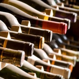 Wine bottles on a wine rack.
