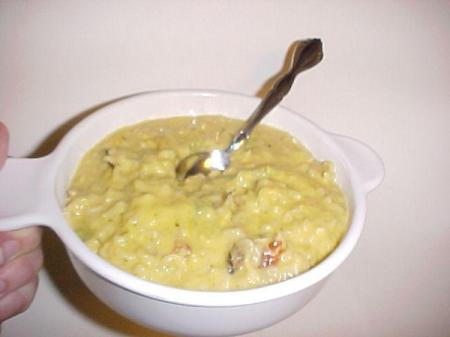 Soup bowl with Broccoli Cheese Noodles and a spoon