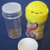 Recycled spice jars for storing garden seeds.