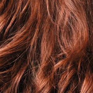Up close photo of red, wavy hair.