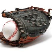 A baseball glove with a baseball.
