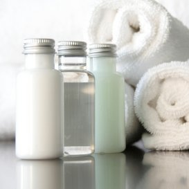 Homemade bath products in clear bottles.