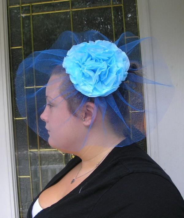 Woman wearing a handmade Fascinator